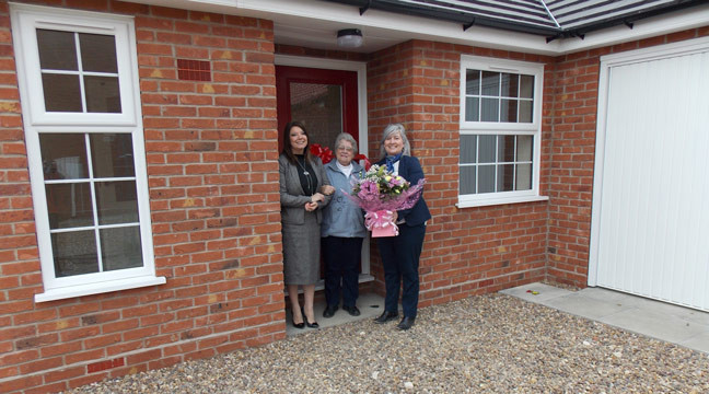 Sales Team at Curtis Fields hand over keys to first resident to move in on new phase